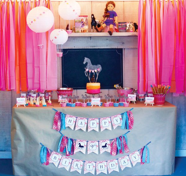 bright pink and orange horse themed party dessert table