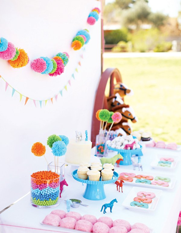 pony and pom-pom birthday party dessert table