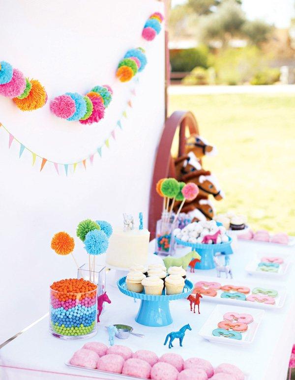 pony and pom-pom birthday party dessert table