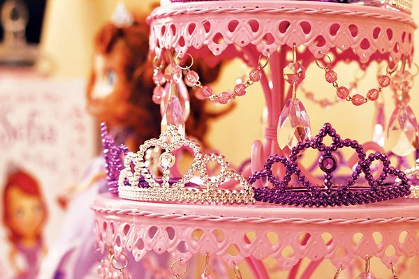 Pink cake stand with princess crowns, beads and jewels