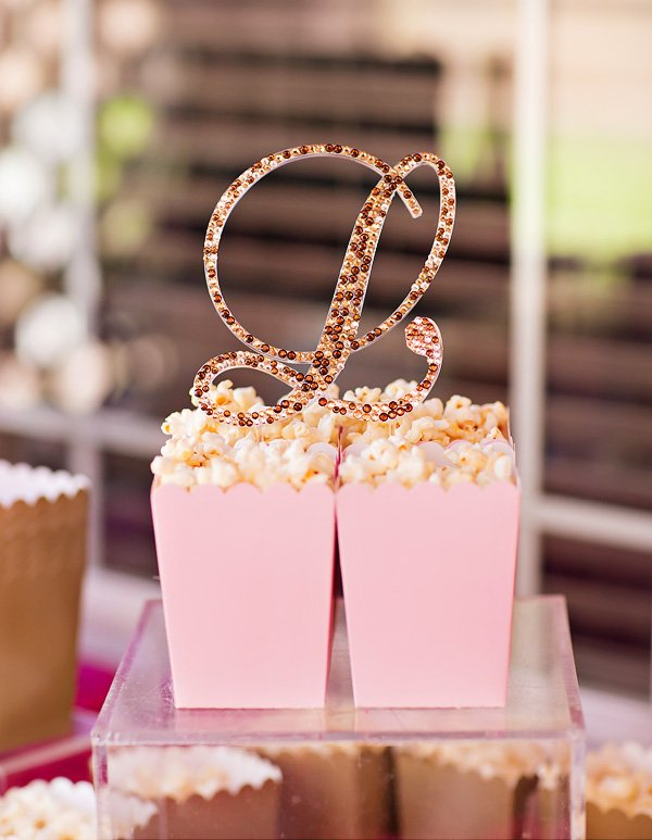 pink bags of popcorn with a rhinestone sign