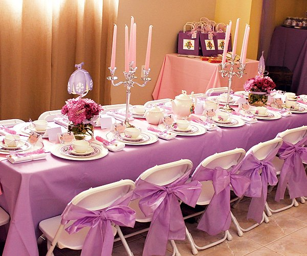 A tea party with lavender bows and linens, pink candelabras and princess dresses