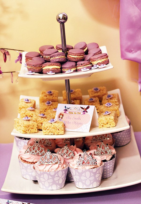 Purple macarons, rice krispies and princess cupcakes