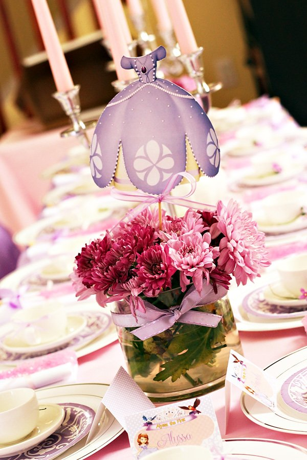 Princess tea party centerpiece with flowers and princess ball gown