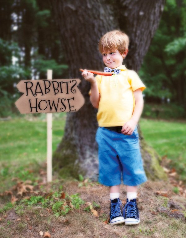 Christopher robin at the rabbits house during a winnie the pooh party