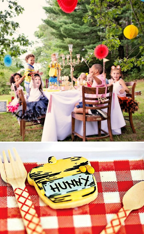 Winnie the Pooh Party table with kids in costume and hunny pot sugar cookies