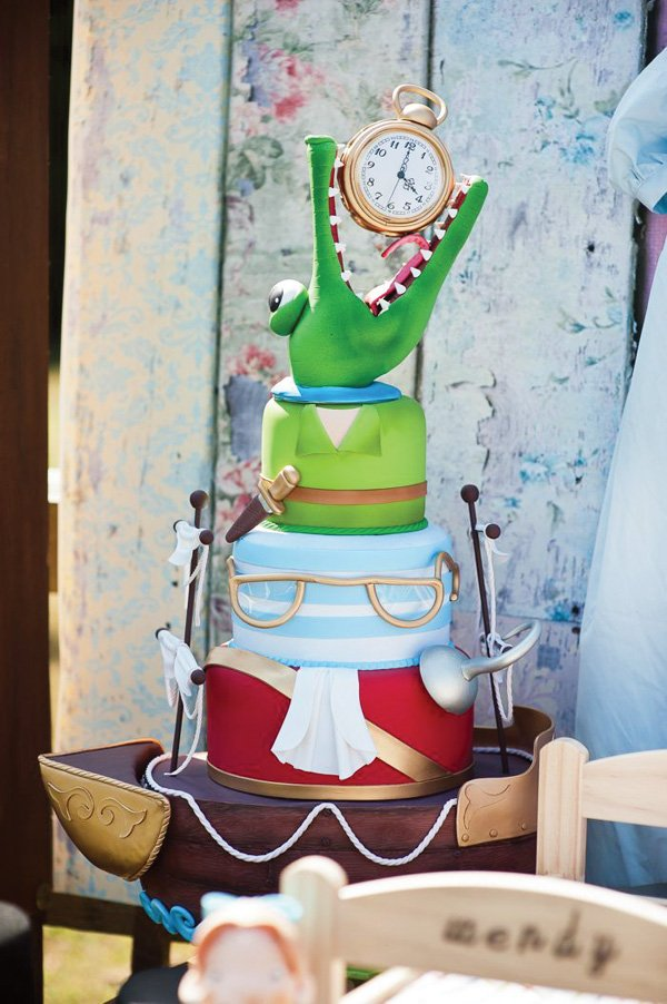 an amazing crocodile topped peter pan ship cake for a Neverland themed birthday party