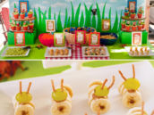 bug party food and dessert table banana and grape caterpillars