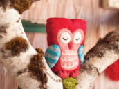 handmade red felt owl in a tree
