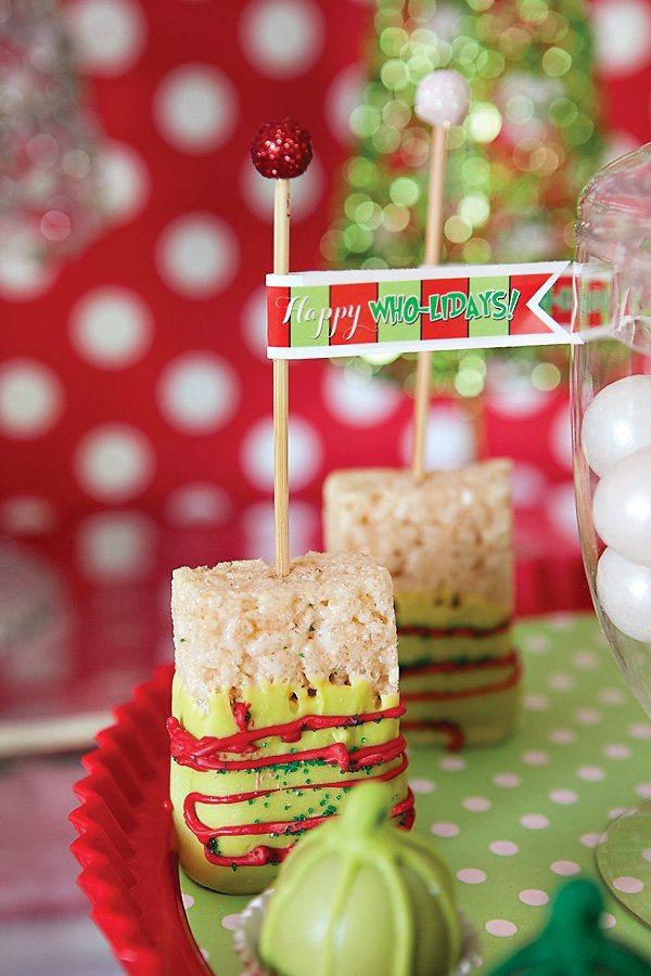 red and green christmas chocolate dipped rice krispy treats on sticks for a grinch holiday party