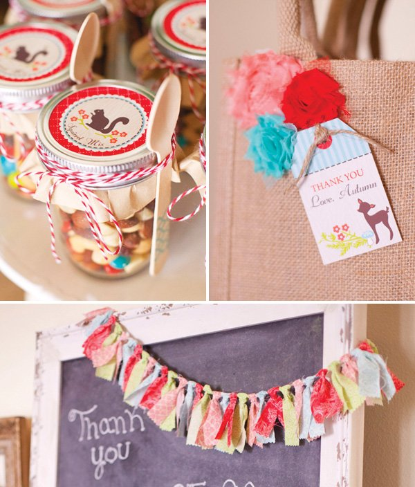 woodland party decorations with rag tie bunting, tulle flowers and mason jars