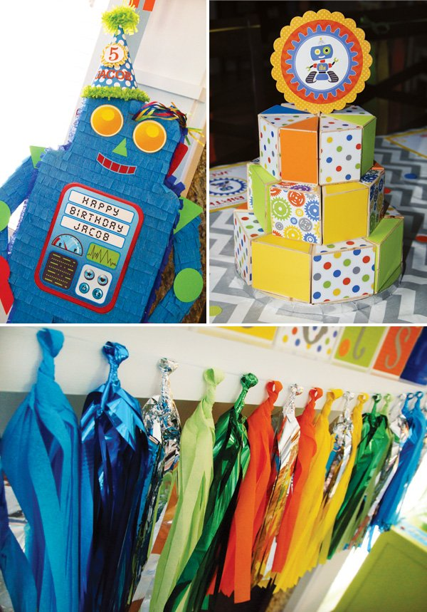 blue robot piñata, wooden cake and tassel garland