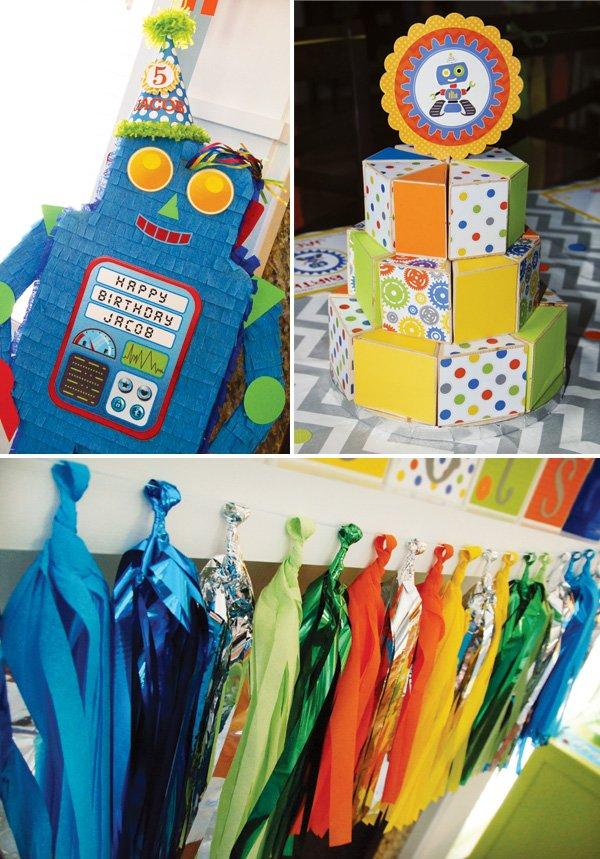 blue robot piñata, wooden cake and tassel garland