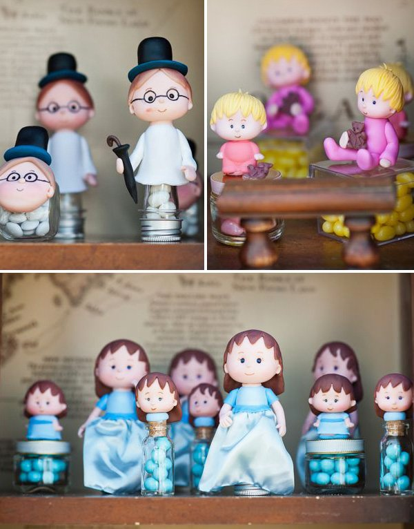 fondant wendy, john and michael characters from peter pan on top of candy jars