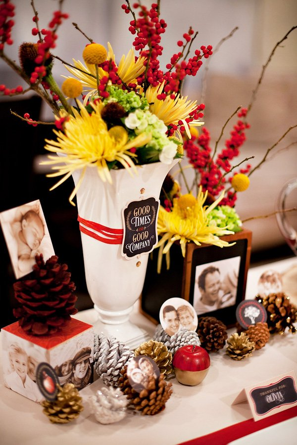 holiday centerpiece idea with pinecones and red ribbon