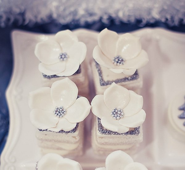 silver and white layer cupcakes with fondant flowers
