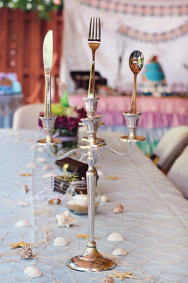 the little mermaid candelabra with silverware centerpiece