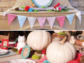 woodland party tablescape with garland and white pumpkin centerpieces