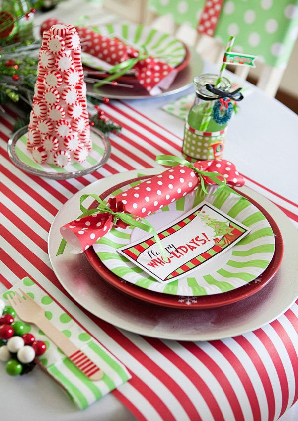 red and green christmas place setting for a grinch themed holiday party
