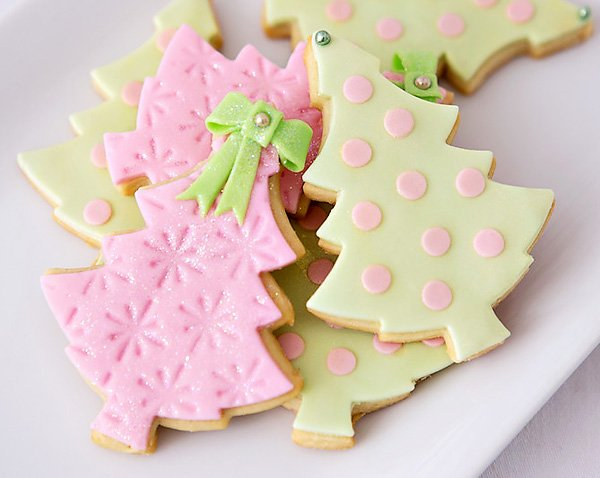 Mint and pink polka dotted and snowflake stamped christmas tree cookies