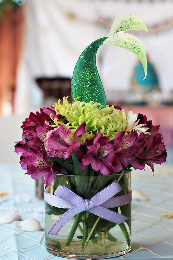 the little mermaid under the sea party centerpiece with mermaid tail