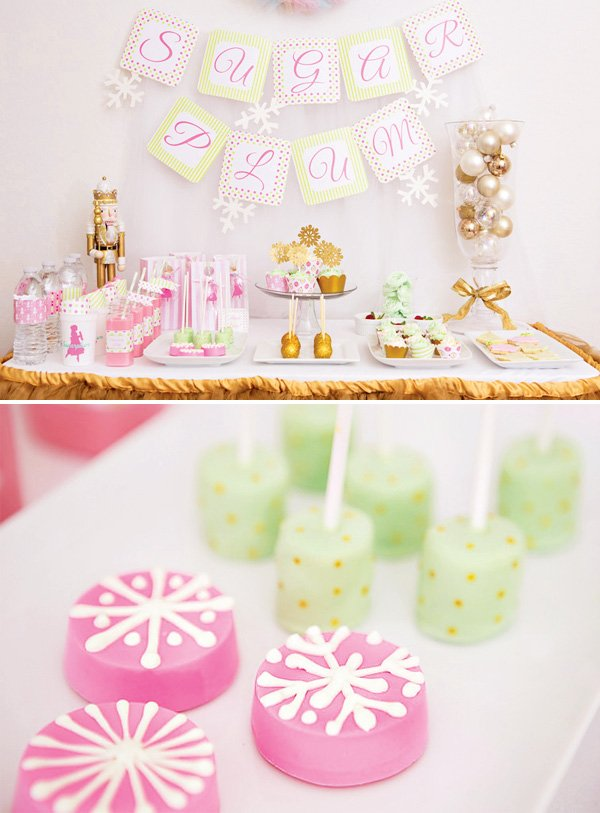 Sugar plum fairy holiday dessert table with marshmallow pops and snowflake cookies