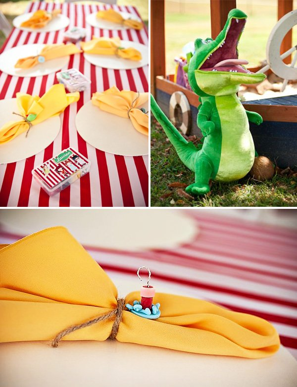 the kids table at a peter pan birthday party with stuffed crocodile