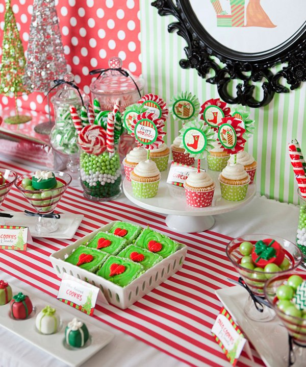 grinch inspired red and green christmas party dessert table
