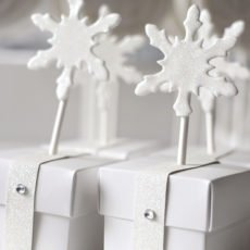 white glitter and snowflake party favor boxes