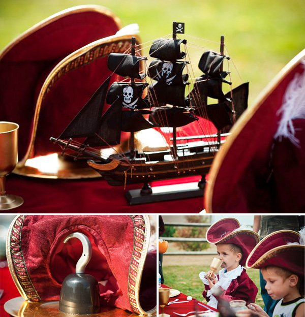 a captain hook kids table with pirate ship and costumes