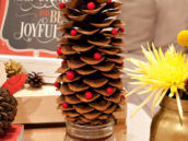 the christmas decoration was pinecone christmas tree with red pom-poms as ornaments