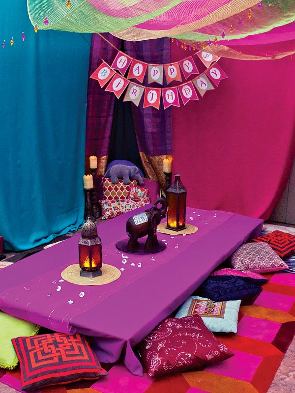 bollywood party tablescape inside a tent