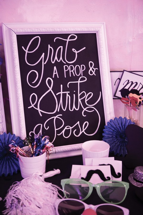 a chalkboard photo booth prop sign for a purple wedding