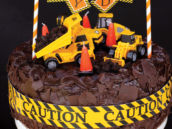 DIY construction party cake with dump truck topper