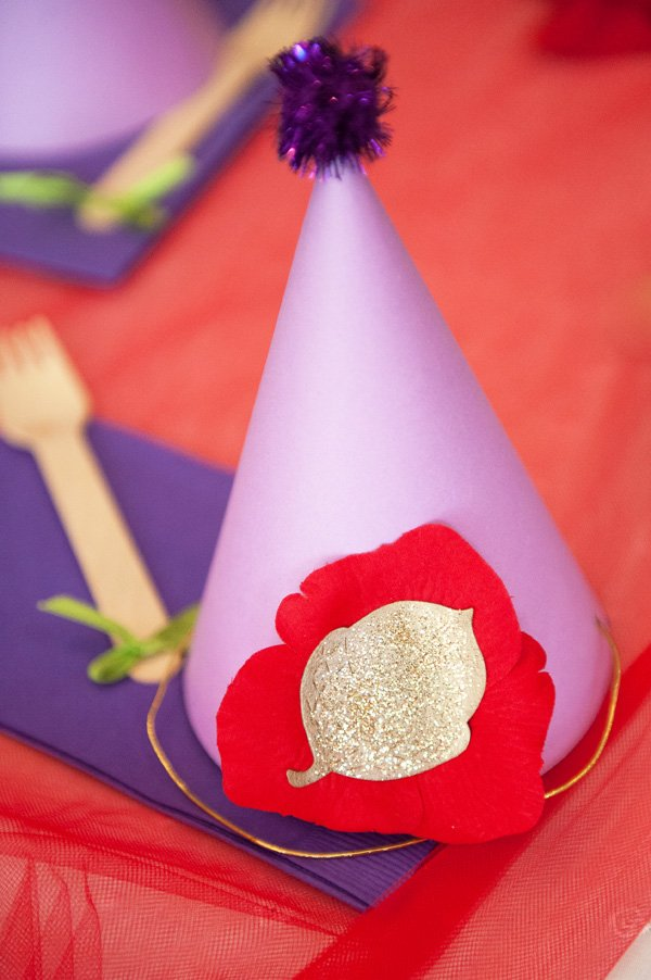 DIY purple party hat with red petals and gold glitter leaf for the birthday girl
