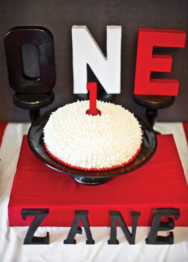 red black white first birthday smash cake