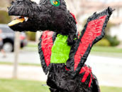 black, green and red dragon pinata for a ninjago birthday party