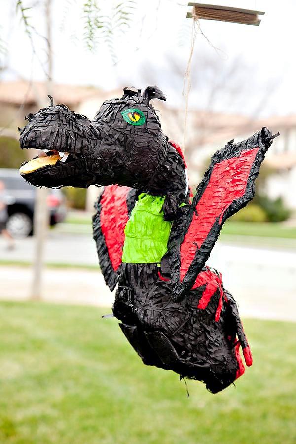 black, green and red dragon pinata for a ninjago birthday party