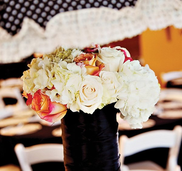 elegant paris themed floral centerpiece with roses and hydrangeas