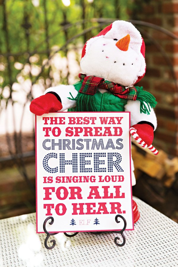 elf quote with a stuffed snowman at a tacky christmas party