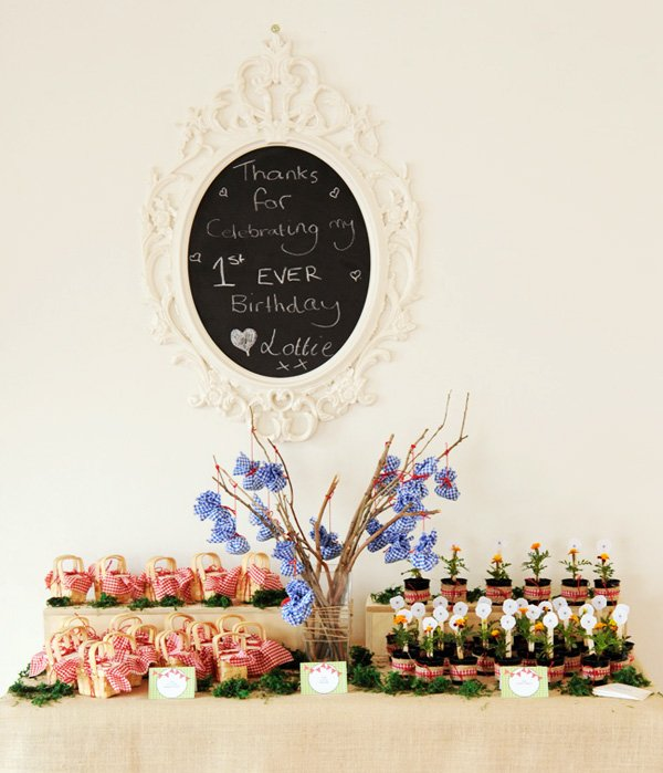 little red riding hood party favor table with chalkboard sign