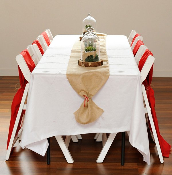 little red riding hood fairytale tablescape with burlap and terrariums