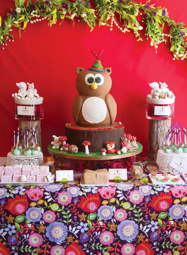 Modern woodland birthday party with owl cake and dessert table