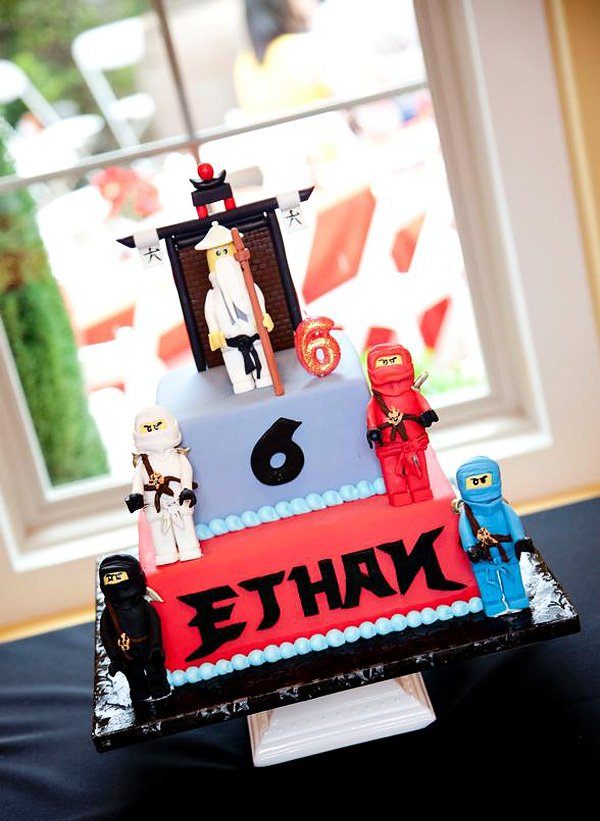 ninjago lego boy's birthday party cake with ninja warriors and sensei