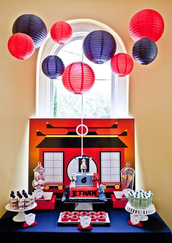 hanging lanterns over a ninjago themed birthday party dessert table