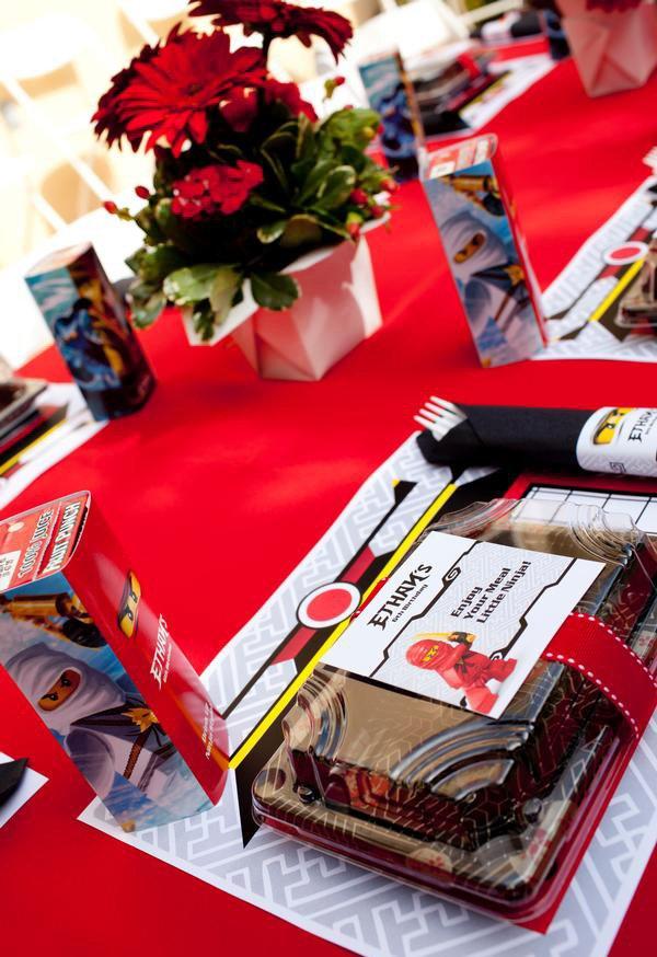 ninjago themed birthday party bento boxes at the kids table