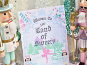sugarplum fairy nutcracker ballet themed birthday party with land of sweets sign and dessert table