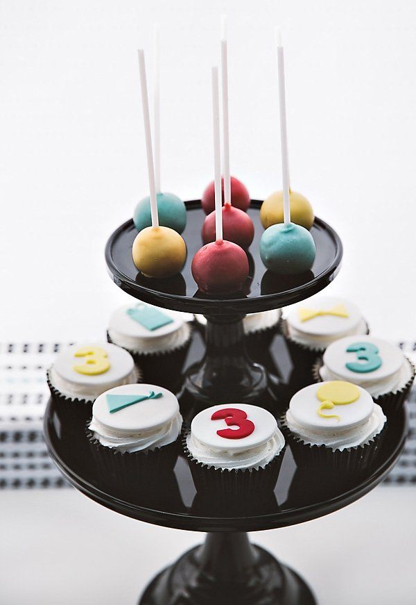 red yellow blue cake pops and birthday cupcakes