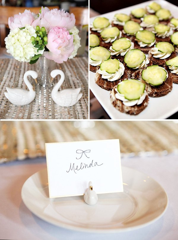 the romantic bridal shower food was an assortment of tea sandwiches. Also on the table were handwritten place cards in swan holders