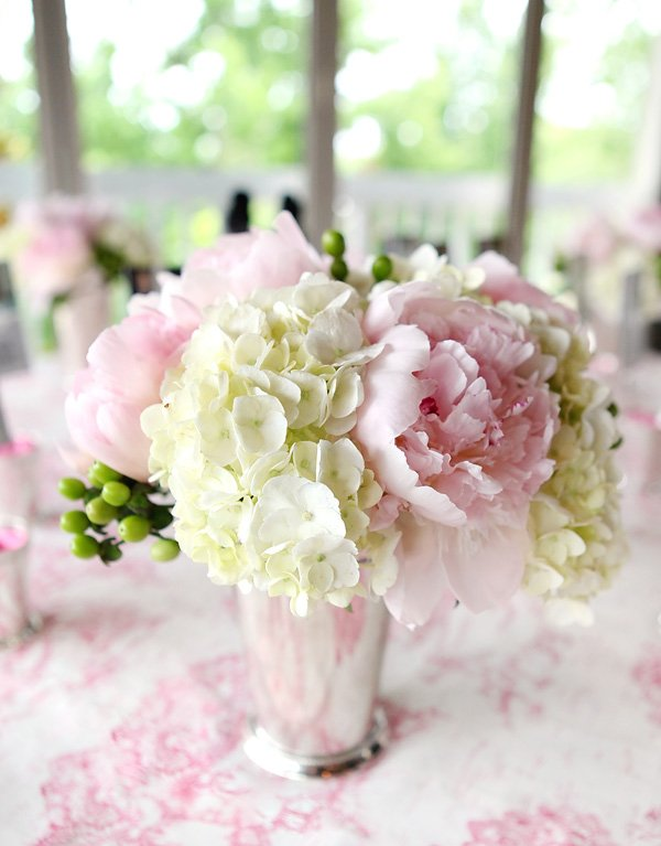 romantic centerpiece bouquets with pink peonies, and white hydrangeas inside mint julep glass vases